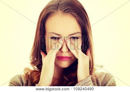 Woman suffering from sinus pressure pain.