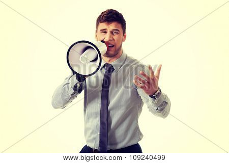 Handsome businessman shouting through megaphone.