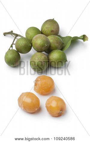 Fresh quenepa fruit on white background