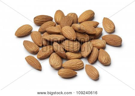 Heap of shelled sweet almonds on white background