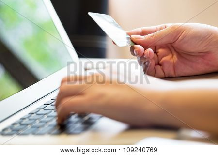 Woman Holding Credit Card On Laptop For Online Shopping Concept