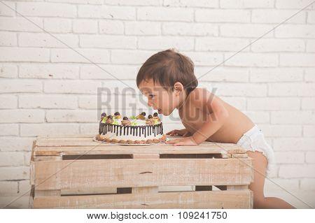 Cute Caucasian Boy Eating A Cake