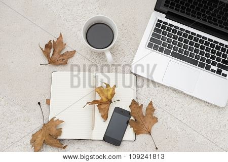 Laptop, Smart Phone Cup Of Coffee And Notebook Located On Carpet Background