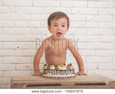 Cute Caucasian Boy Scream In Front Of A Cake
