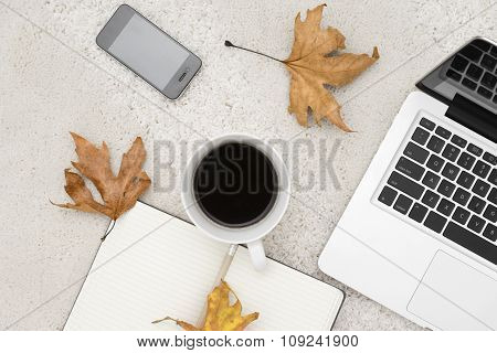 Laptop Smart Phone Cup Of Coffee And Notebook Located On Carpet Background,