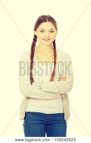 Beautiful smiling student woman with crossed arms.