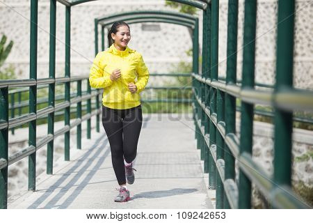 Young Asian Woman Exercising Outdoor In Yellow Neon Jacket, Jogging