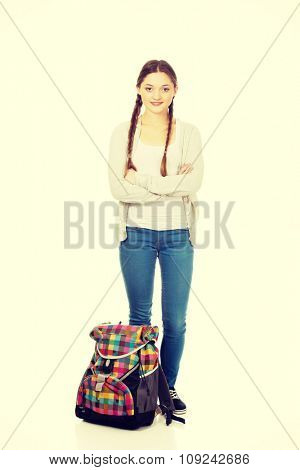 Happy confident teen woman with backpack.