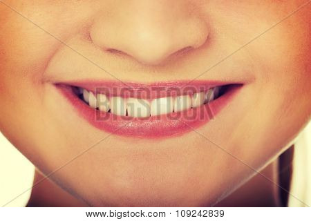 Beautiful young woman's toothy smile.