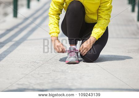 Hand Tying A Shoelace While Exercising