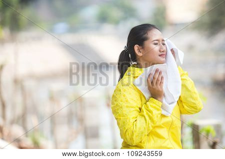 Wiping Her Sweat With A Towel