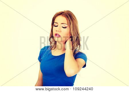 Beautiful young woman with neck pain.