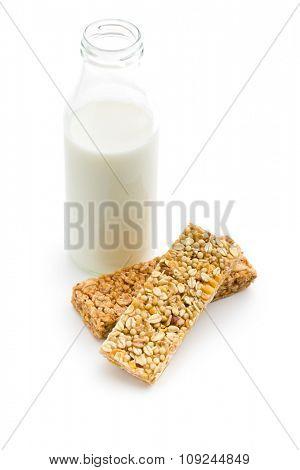 muesli bar and milk in glass bottle