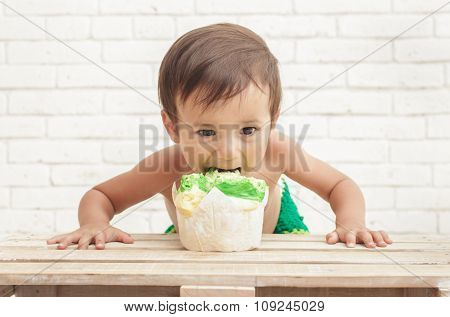 Adorable Handsome Toddler Eating Sponge Cake