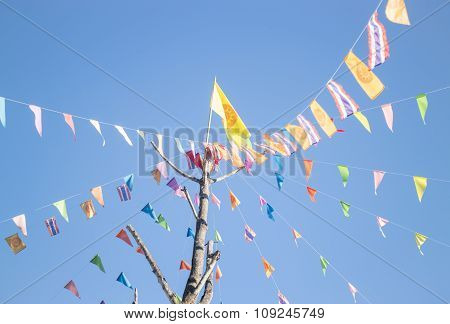 Colorful Flags Of Buddhism Ceremony At Thai Temple