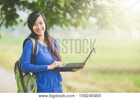 Asian Students Using Laptop Outdoor