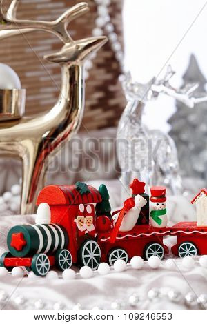 Lovely christmas still-life with train and ornaments.