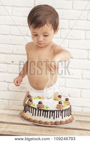 Adorable Handsome Toddler Trying To Cut His Cake