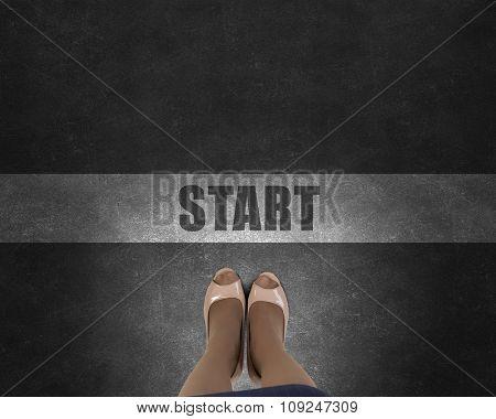 Top view of businesswoman feet standing at start line