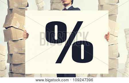 Businessman showing white banner with percent symbol