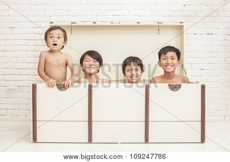 Four Brothers Having Fun Inside Crate