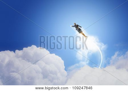 Businesswoman hero in suit flying up into sky