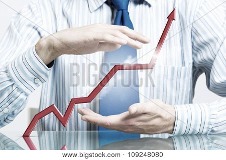 Hands of businessman covering rising growth graph