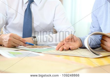 Real-estate agent discussing a  house plans with  a businessman