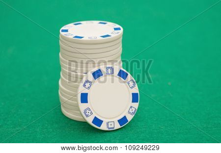 Stack Of White Poker Chips On Green Casino Table