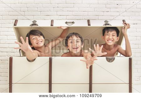 Expression Of Three Cheerful Brothers Inside The Crate