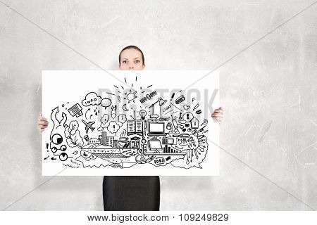 Businesswoman holding banner with business plan and strategy sketches