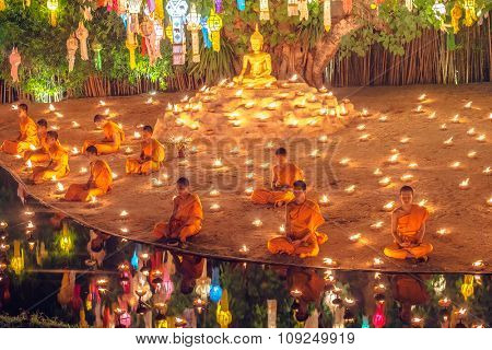 CHIANGMAI,THAILAND - NOV 23: Monks chanting and praying in Loy krathong Festival on November 23th 2015 in Phan Tao Temple.Loy Krathong is a Thai important festival, attracting a lot of tourists.