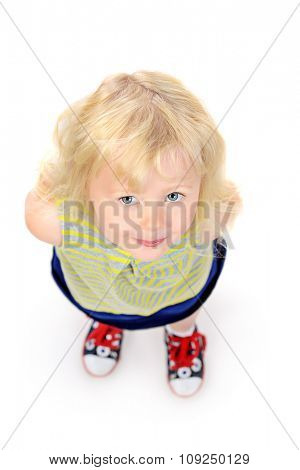Angelic little girl with beautiful blonde hair. Happy childhood. Kid's beauty, fashion. Isolated over white.