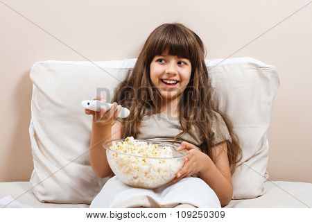 Little girl is watching tv