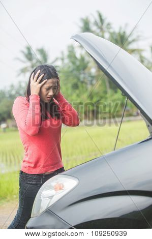Young Asian Woman Holding Her Head, Confuse Because Her Car Trouble