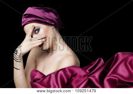 beautiful woman in oriental style with mehendy in hijab