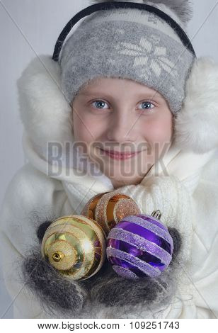 Portrait of a cute baby in a winter hat on a white, Christmas Eve