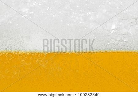 Beer With Foam And Bubbles