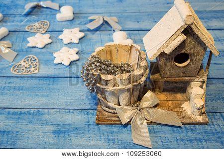 Birdhouse And Christmas Decoration On Blue Background