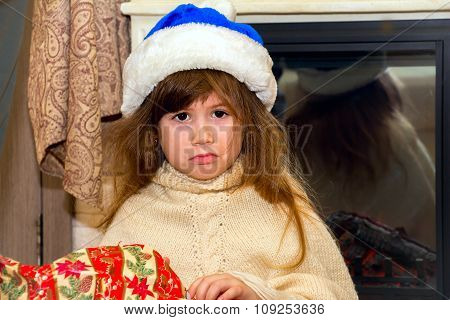 Little Offended Girl Unwraps A Gift.