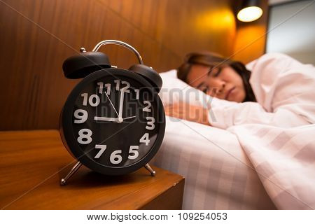 Asian Woman Sleeping In Bed And Alarm Clock
