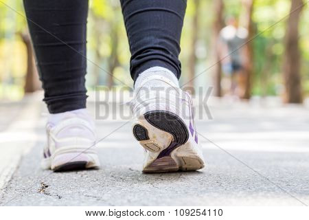 Closeup Of Running Shoes Of Woman Jogging In Park