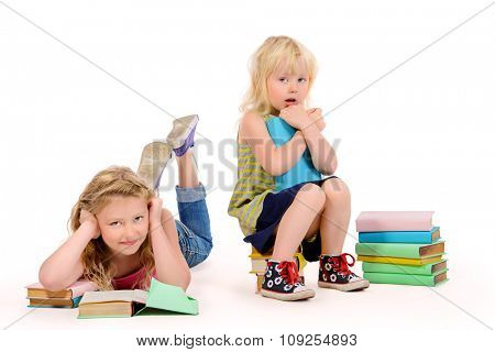 Older and younger sisters spend time reading books. Education. Isolated over white.