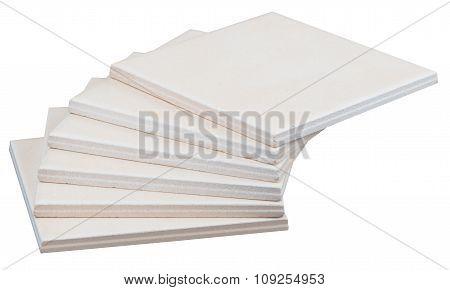 Pile of tiles on white