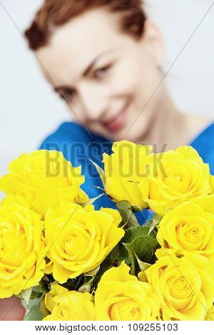 Young Caucasian Woman Posing With The Bouquet Of Yellow Roses