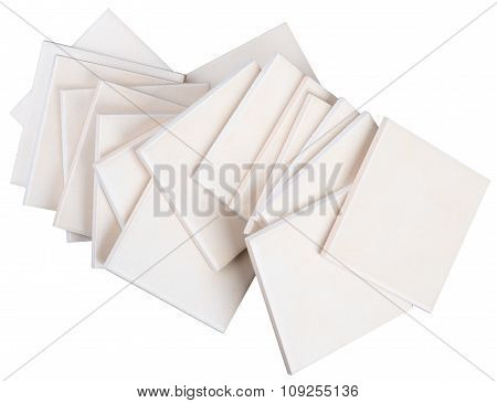 Stack of tiles on white, top view