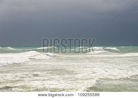 Sunlight Over Stormy Waves
