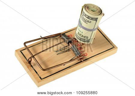Mousetrap with bundle of dollars isolated over white background