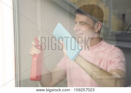 Man Cleaning A Window