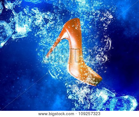 Heeled shoe sinking in clear blue water